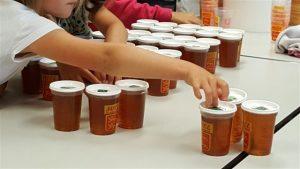 Compte pots de miel